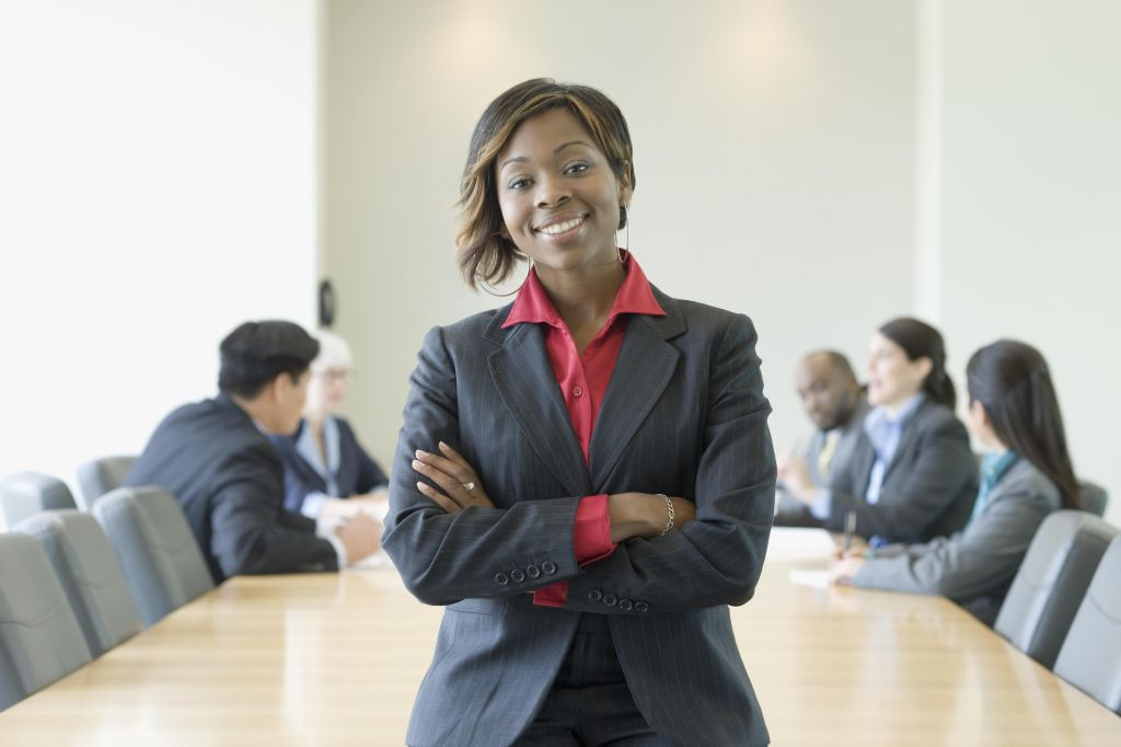 Black businesswoman in conference room with co-workers