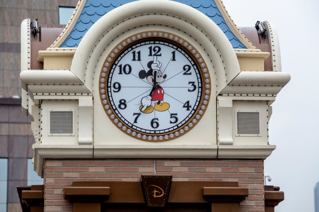 A Mickey Mouse Bell tower on the outdoor plaza. Disney...