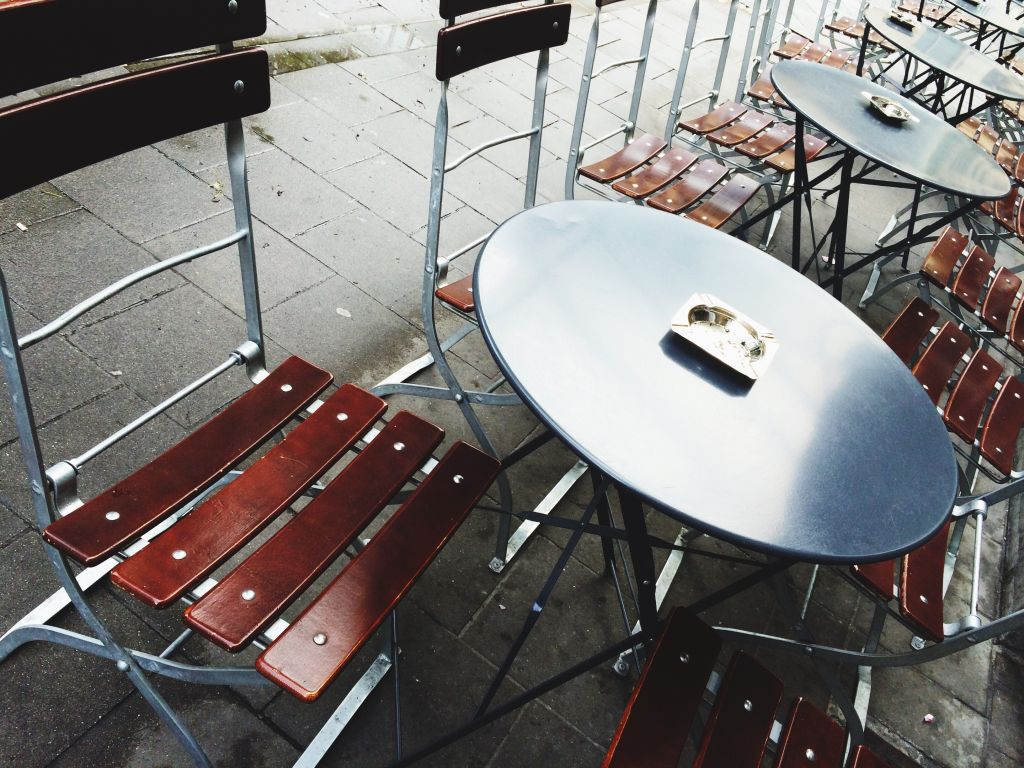 Empty Chairs And Tables Outdoors