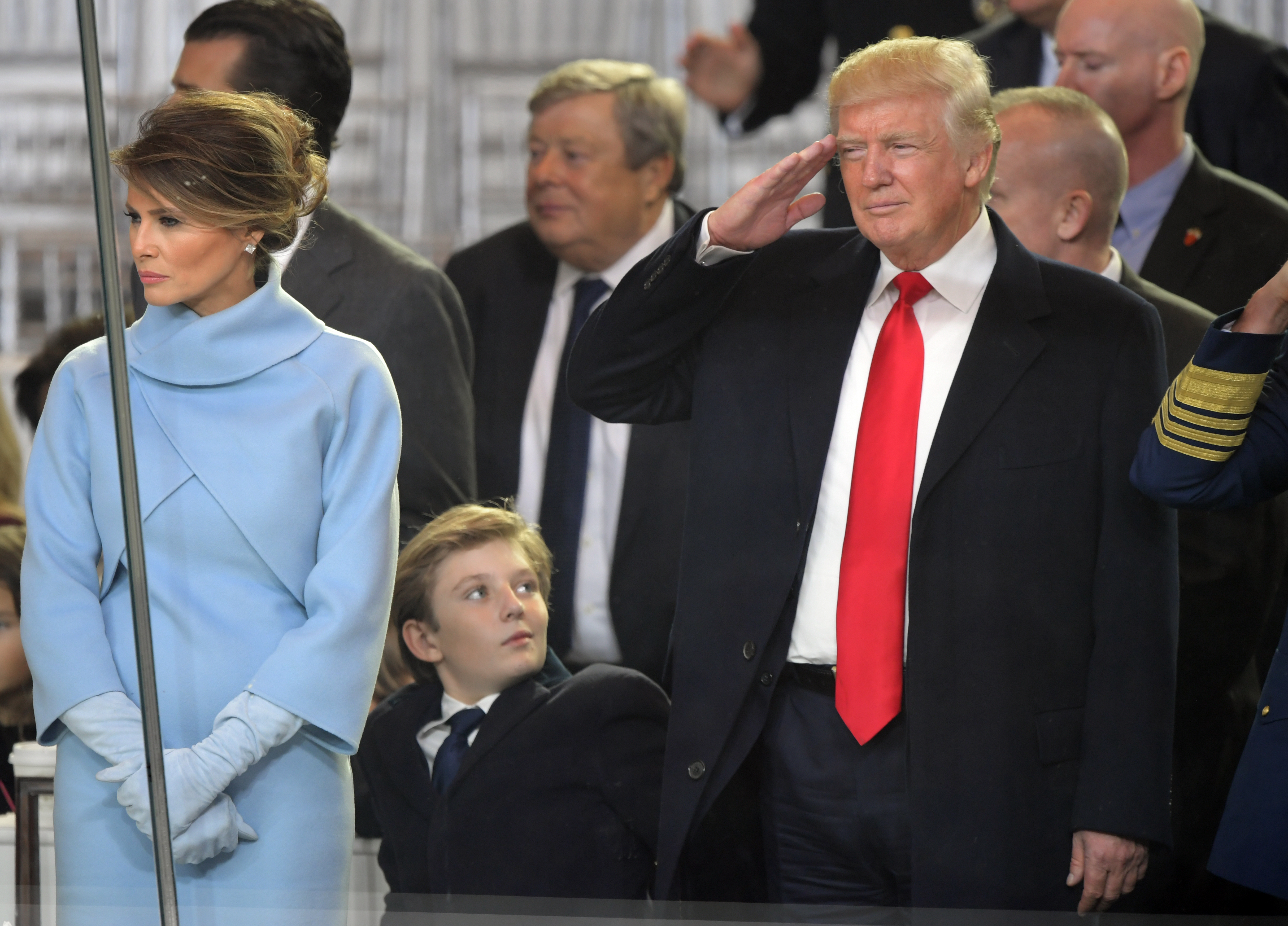 Newly sworn in President Donald Trump with his wife Melania walk down Pennsylvania Avenue in front of the White House