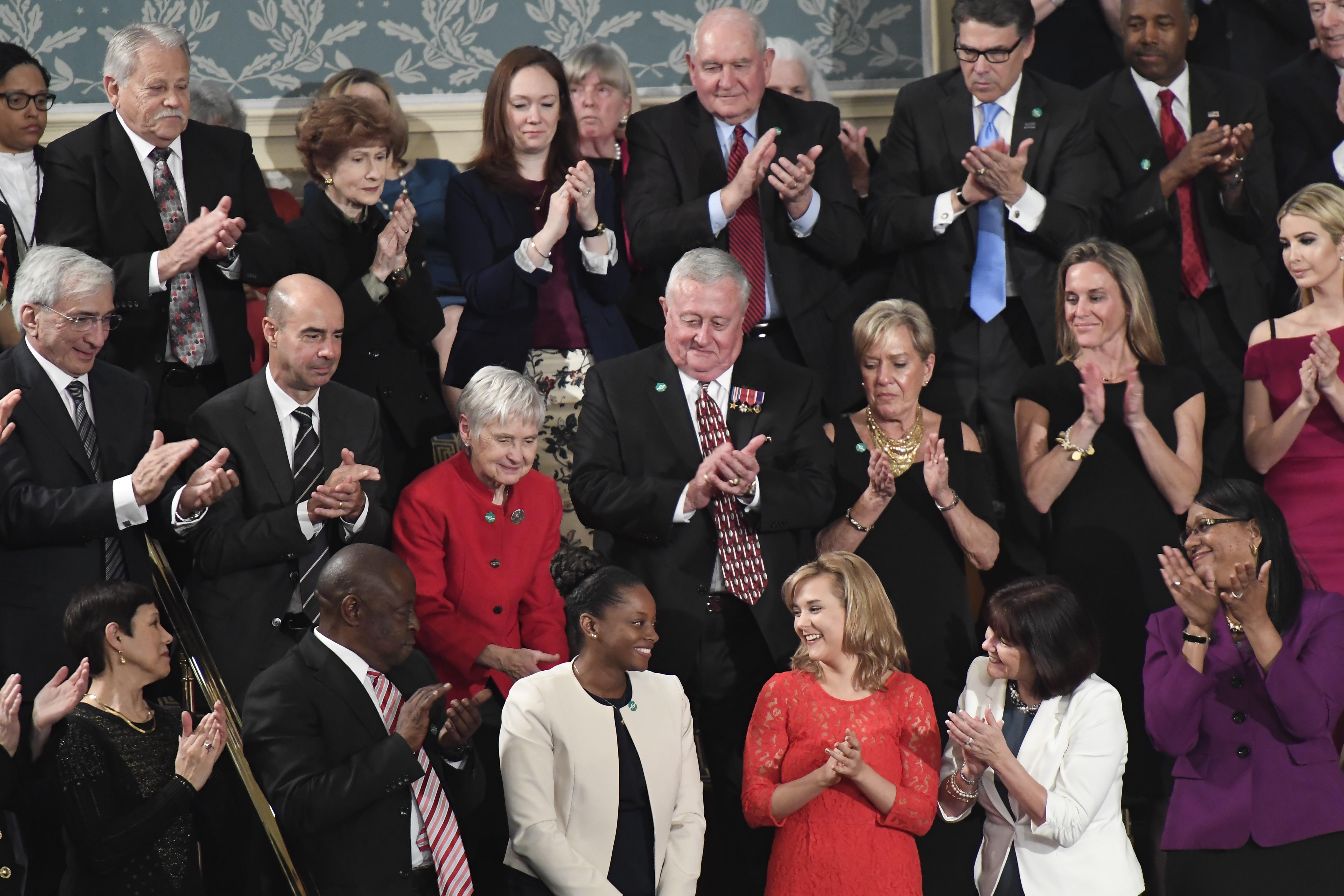 WASHINGTON, DC - FEBRUARY 28: People applaud Denisha Merriweath