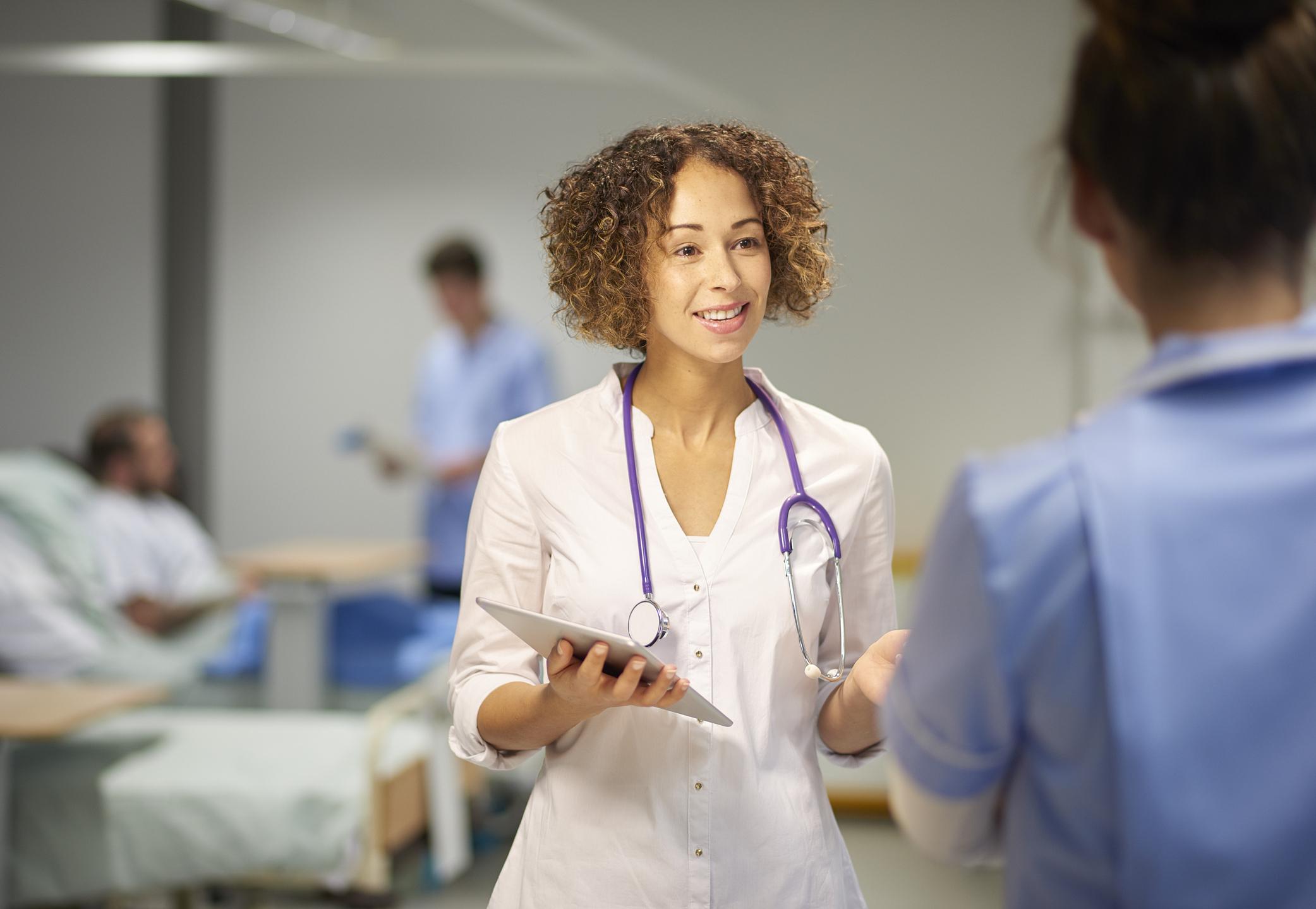 female doctor in team meeting