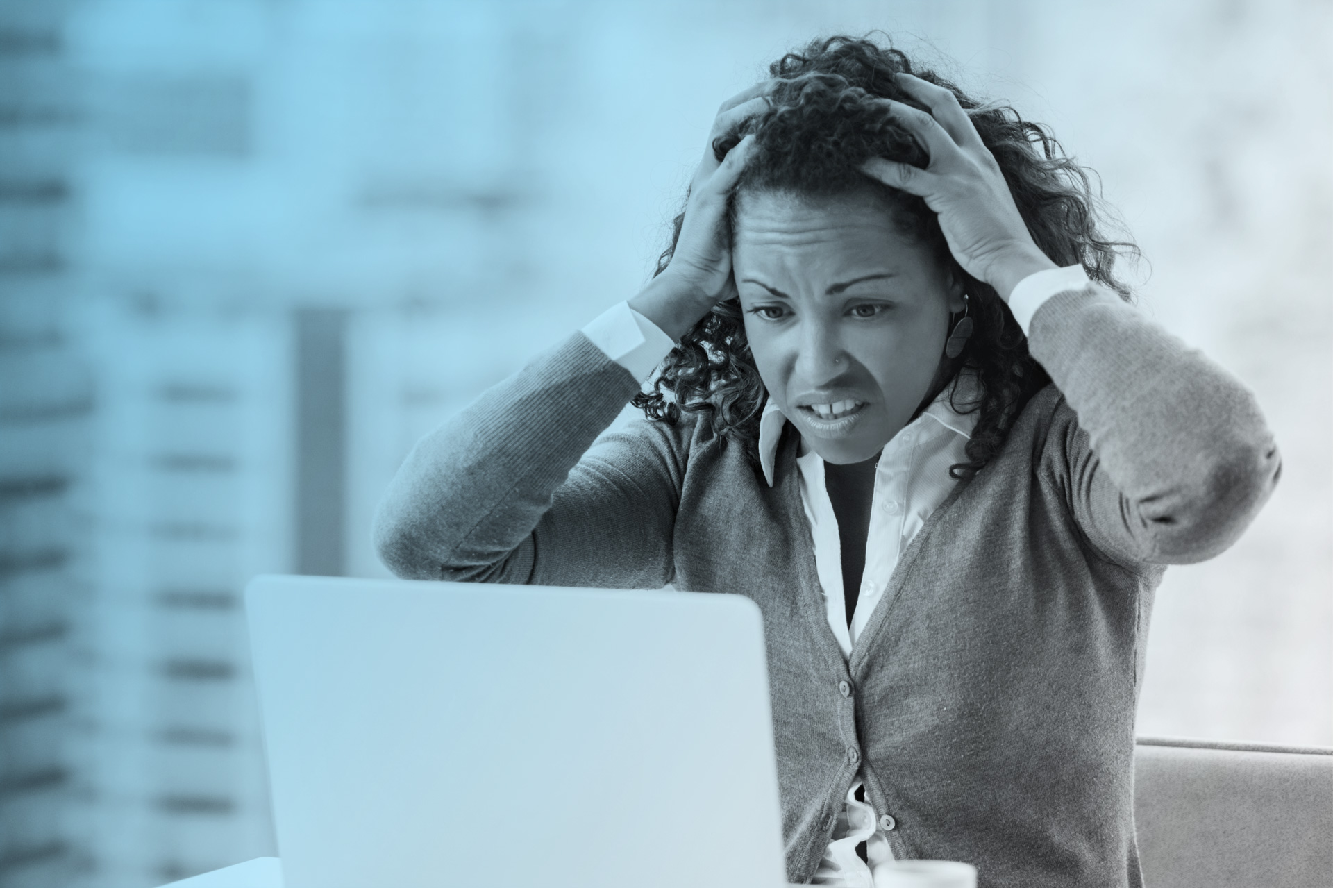 Black woman upset looking at computer