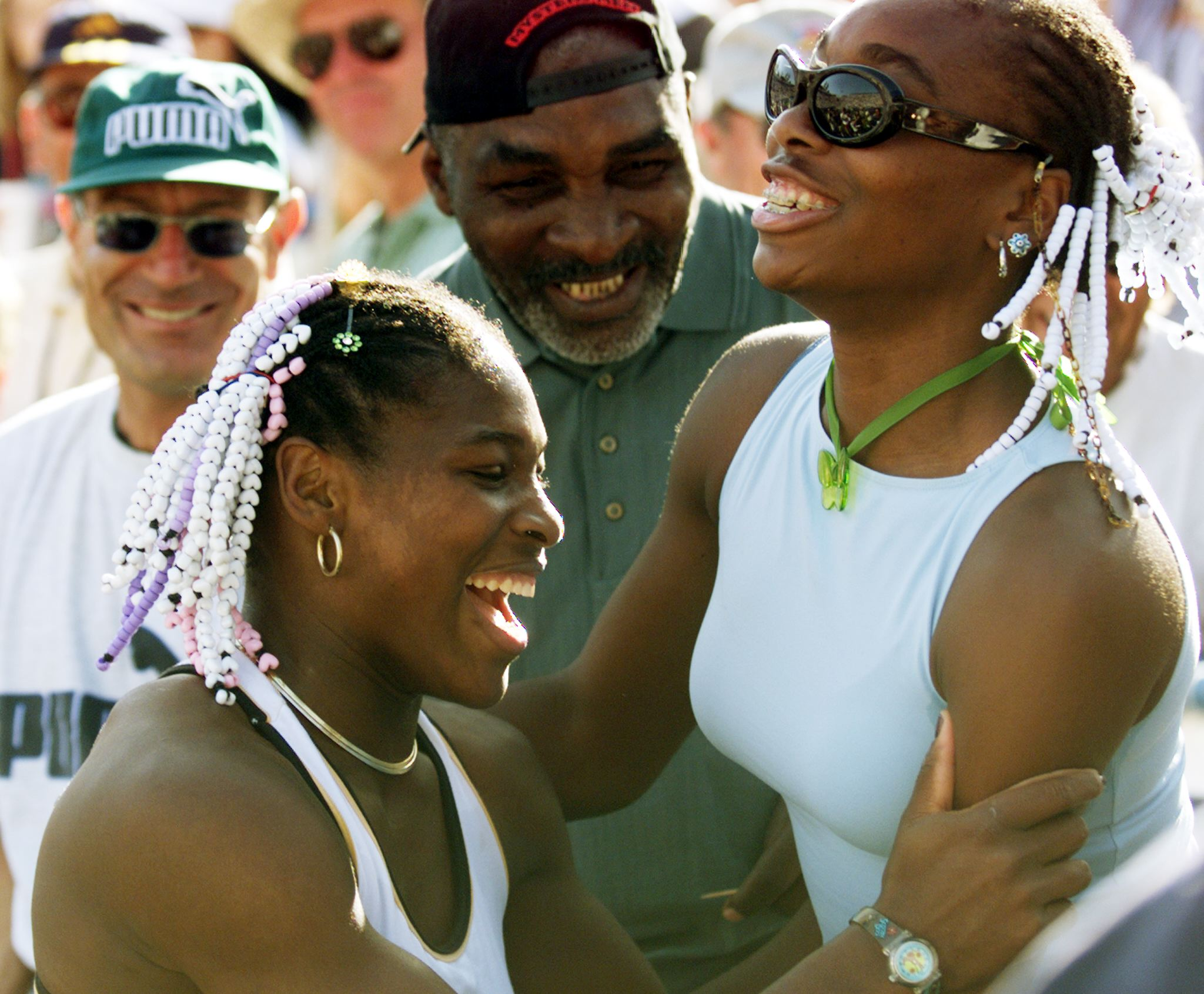 Serena Williams (L) of the US celebrates her Evert
