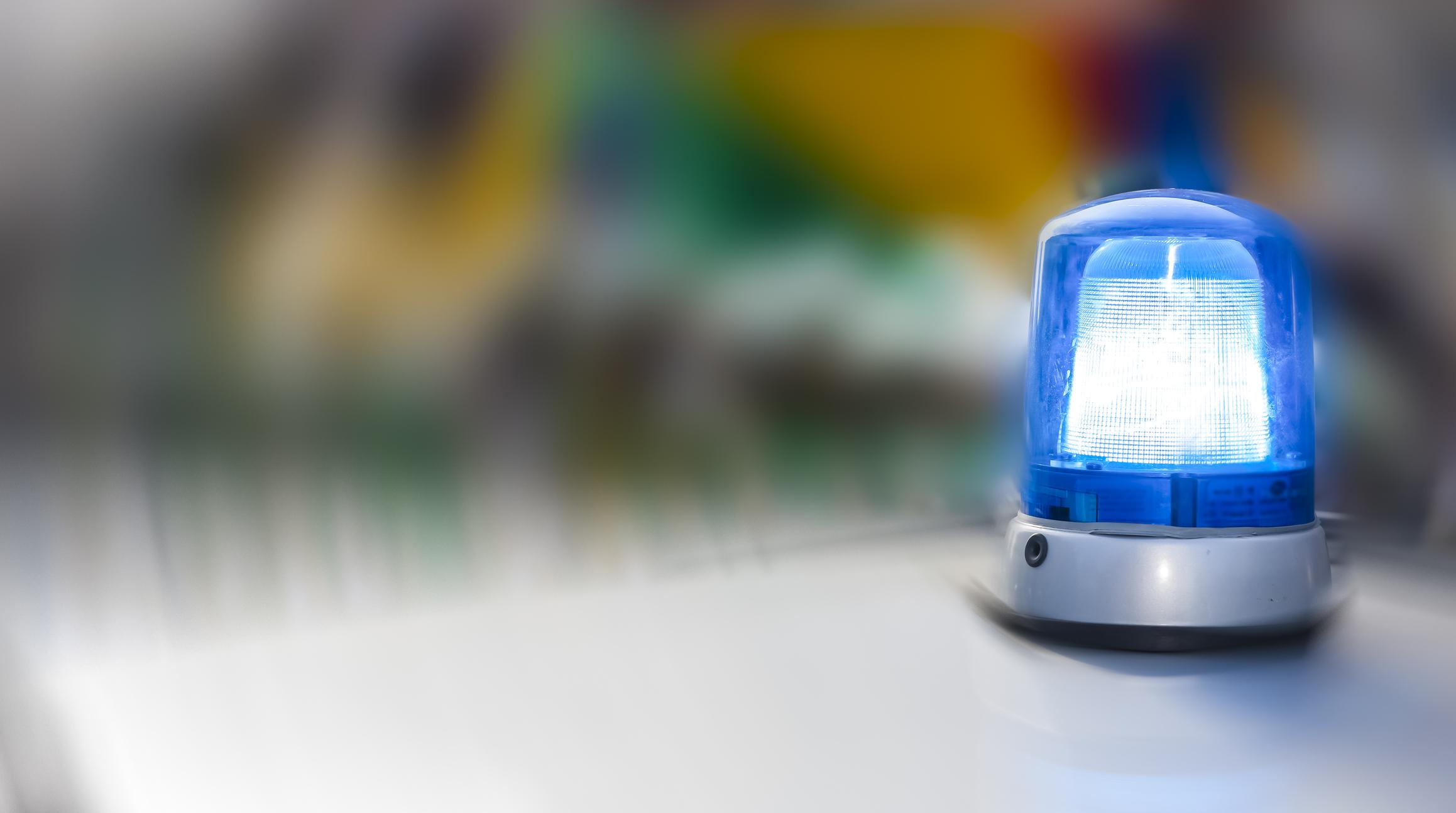 Blue light on police car, close-up