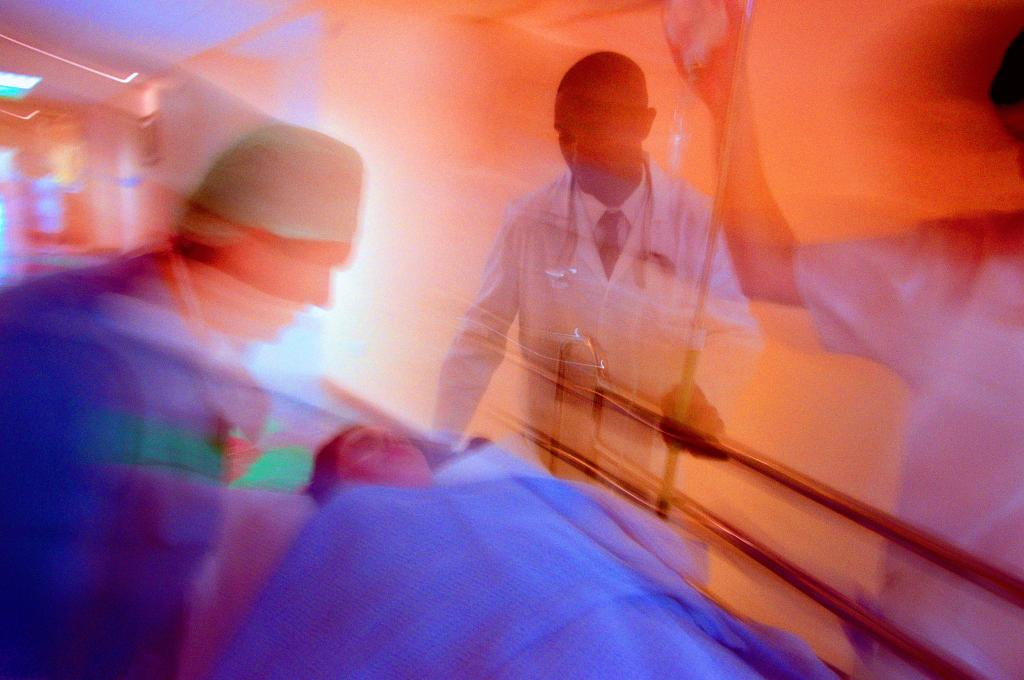 portrait of doctors and a nurse wheeling a patient on a gurney