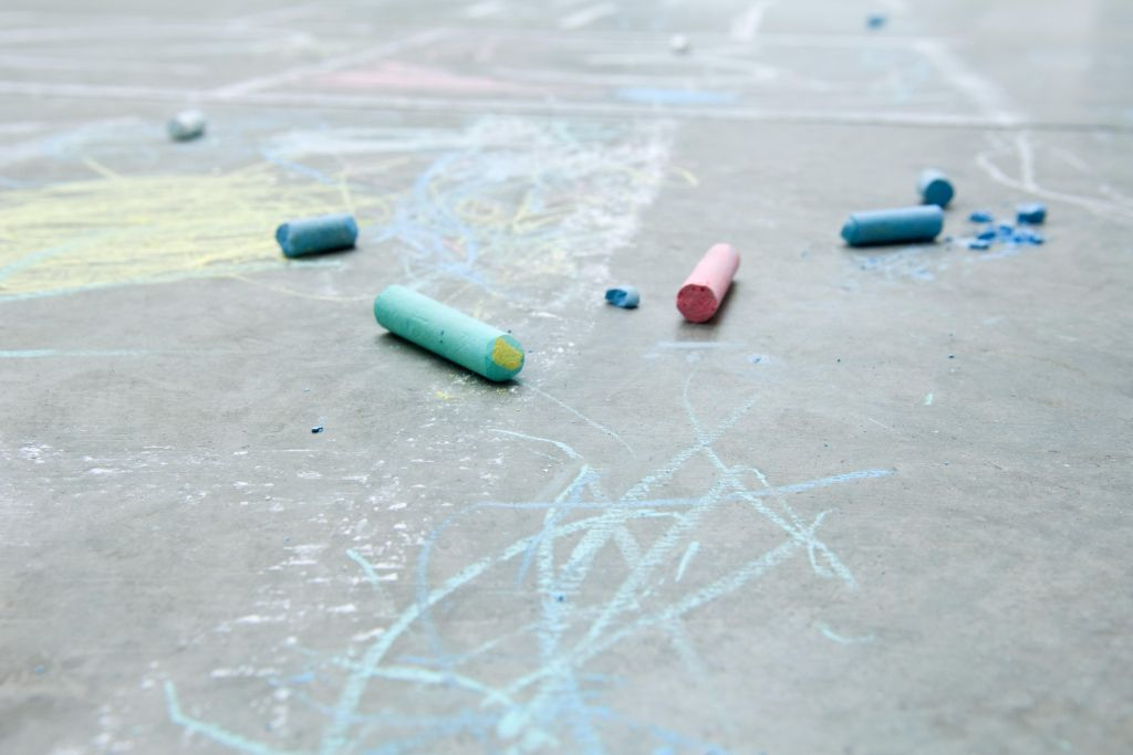 Chalk and drawings on the ground, close-up