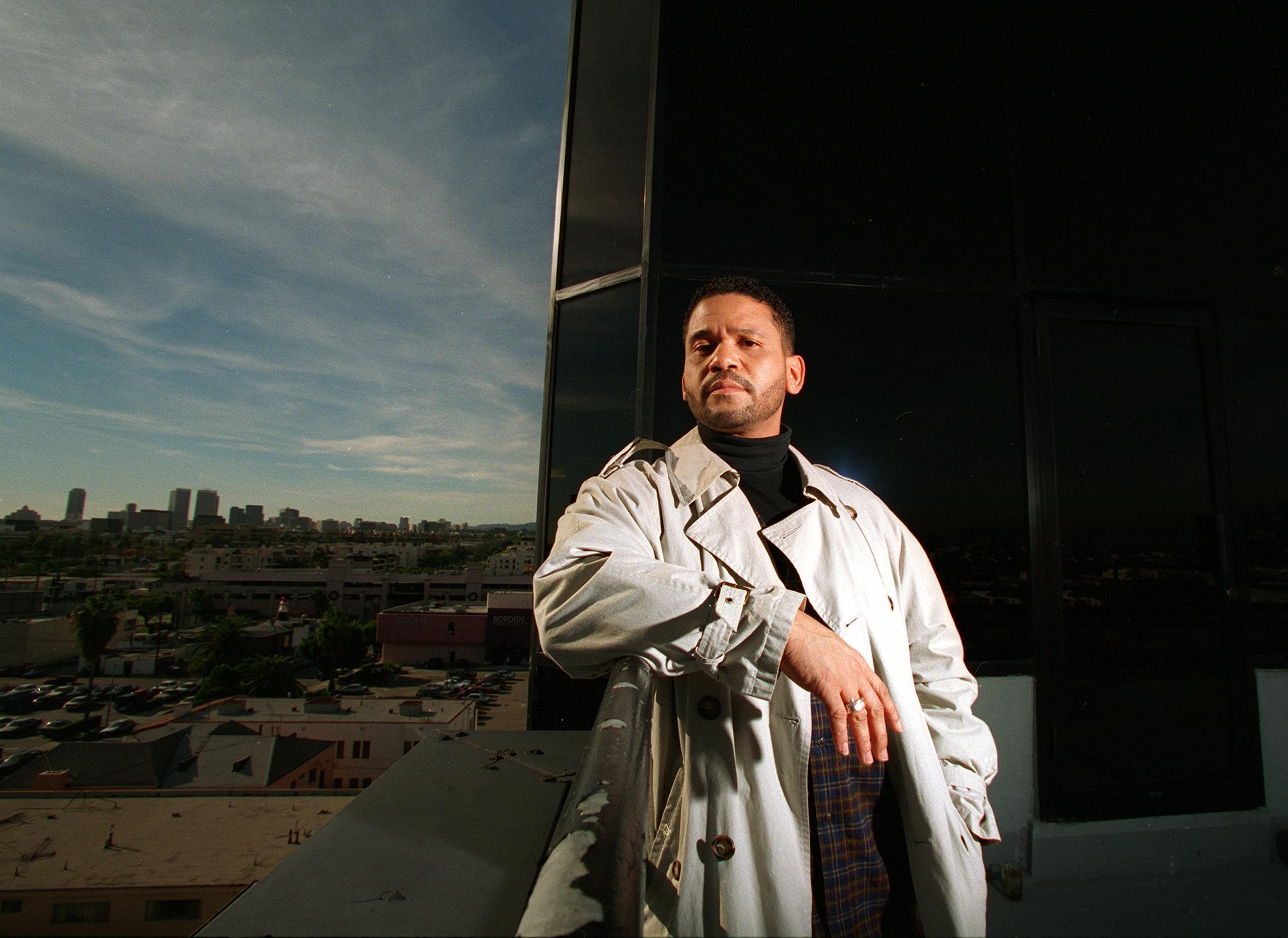 CA.Medina#1.12–17.BC/C.Record producer Benny Medina on the balcony of his Miracle Mile office after