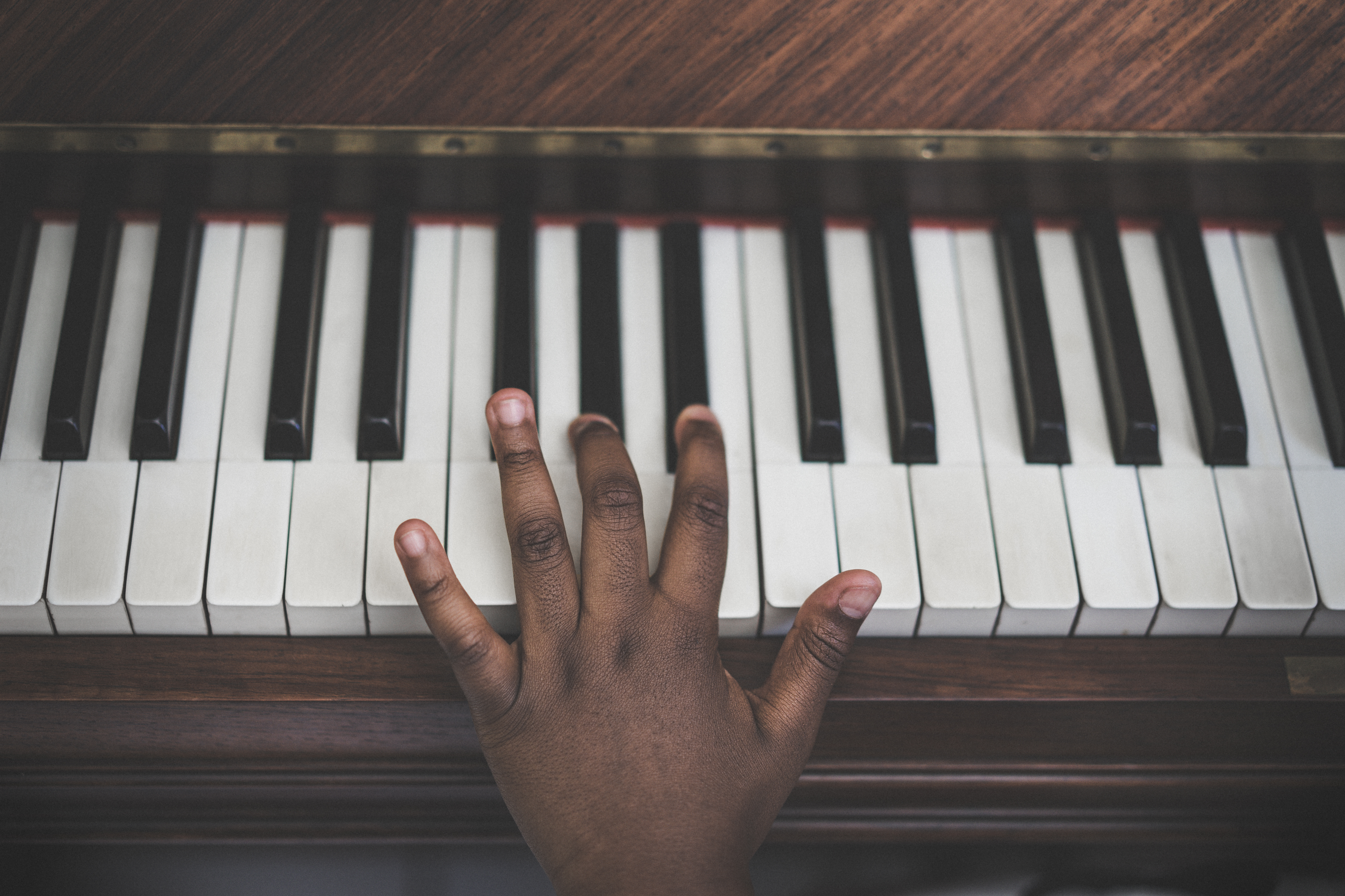 Cropped Hand Playing Piano