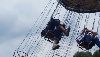 Low Angle View Of Swing Ride At Amusement Park