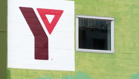 YMCA logo or sign in an old brick wall building. The Young...