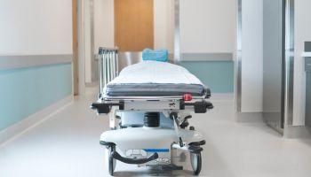 Hospital bed in corridor
