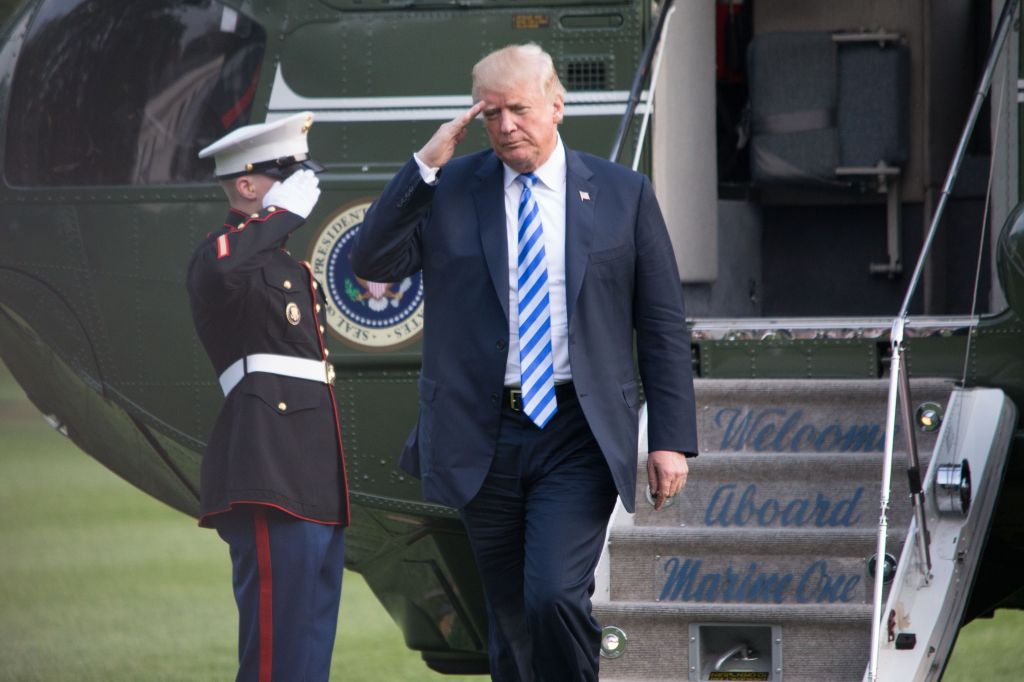 President Donald Trump disembarks Marine One after returning...