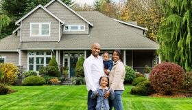 Family of Four at Home in Front Yard