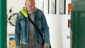 Senior man leaving apartment