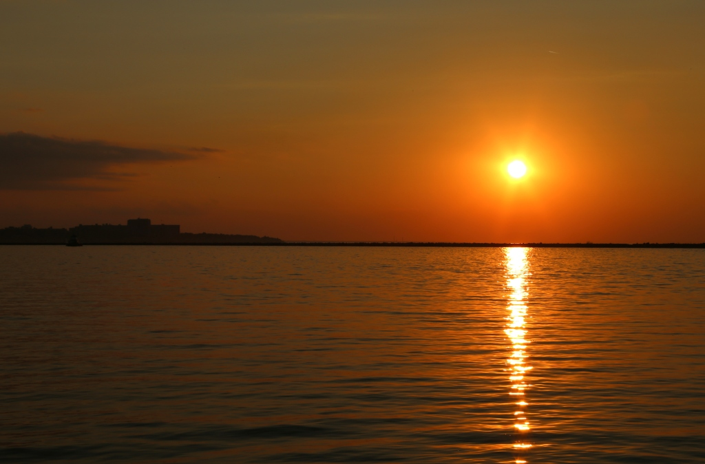 Orange colored sunset over Lake Erie, Edgewater Park, Cleveland, Metroparks, Cleveland, Ohio, USA