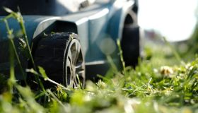 Close-up of a lawn mower on the grass