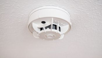 Low Angle View Of Smoke Detector On Ceiling