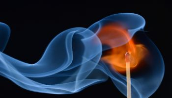 Lit matchstick with a flame and smoke, Germany