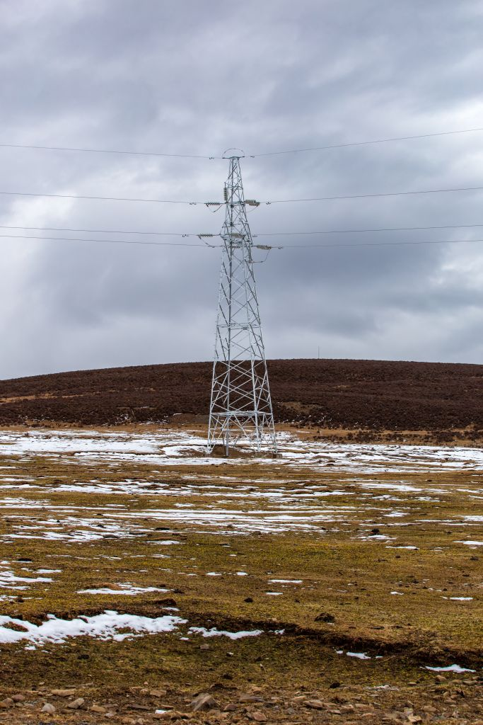 Power line and Beautful snowcapped Mountain