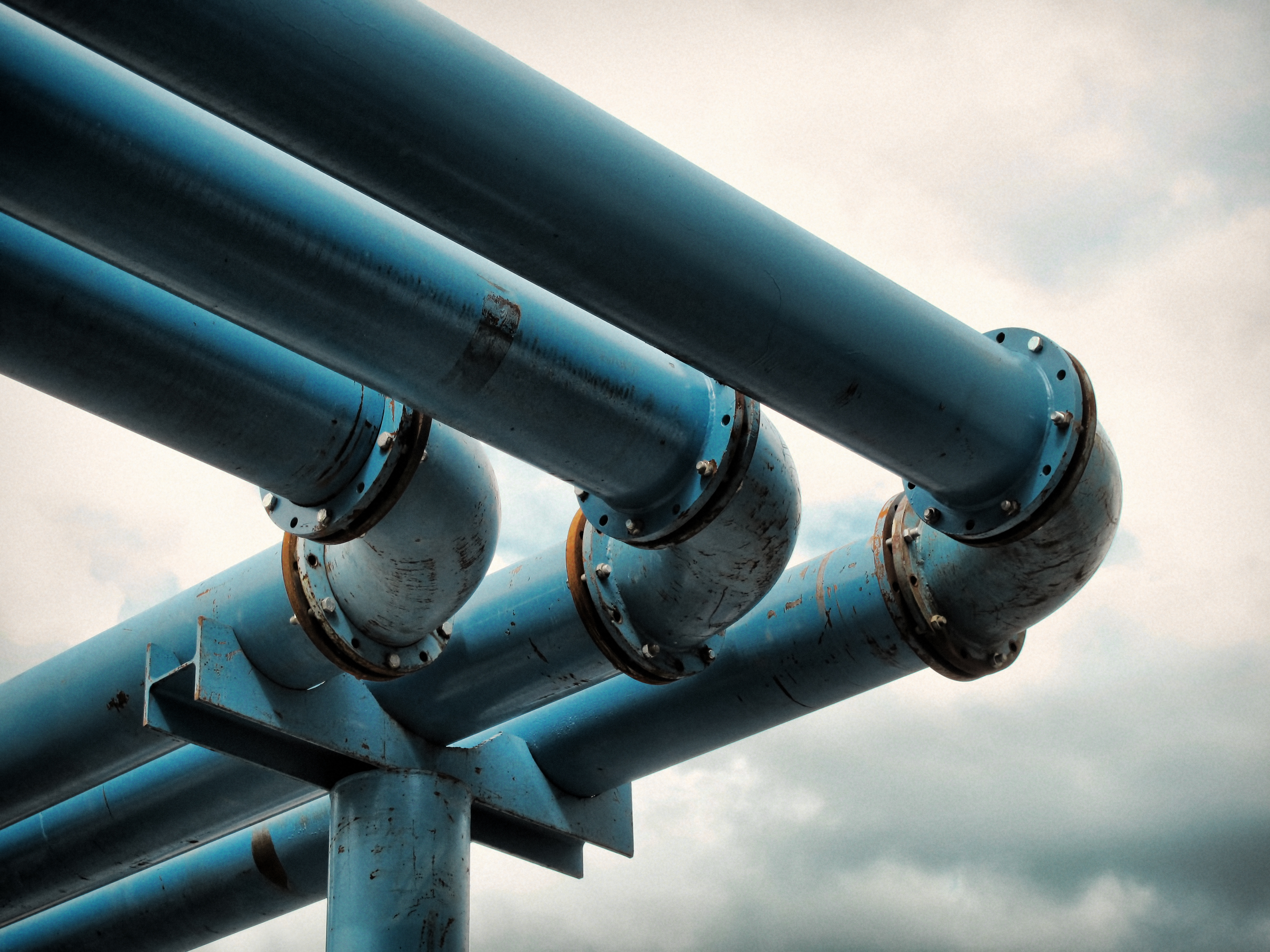 Detail of giant blue-colored water pipes, a peculiar system used to pump away ground-water from flooded foundations of construction sites.