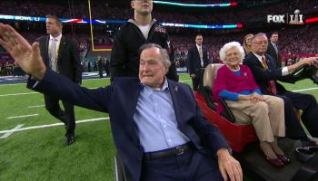 Former President George H.W. Bush performs coin toss at Super Bowl LI alongside Barbara Bush days after leaving the hospital.