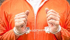 Midsection Of Man With Handcuffs