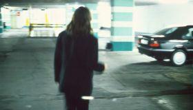 A man in a parking garage