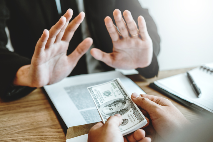 Cropped Hands Of Customer Giving Bribe To Agent