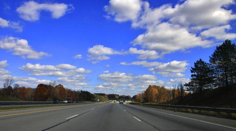 Rural paved Highway under the blue sky