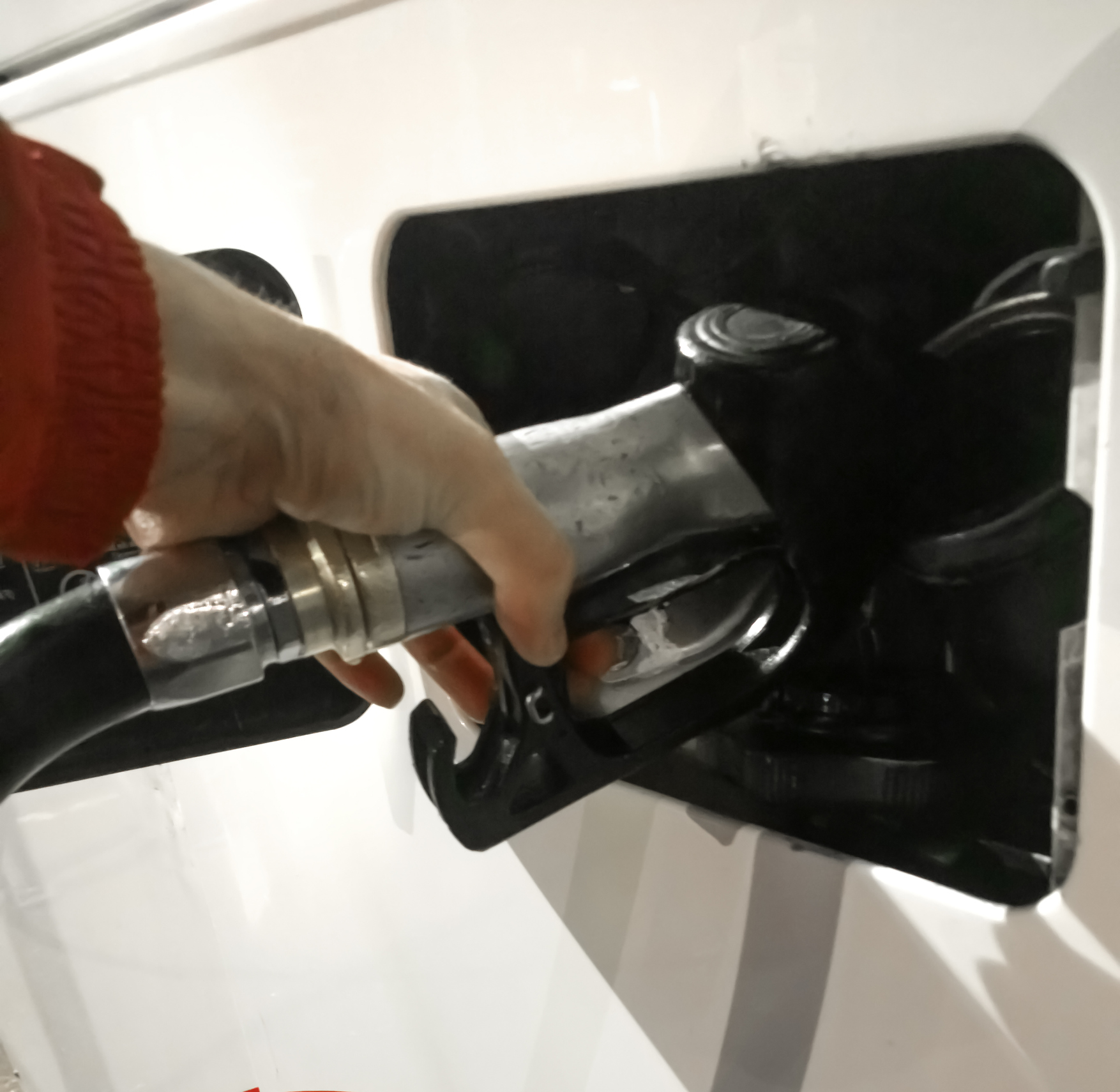 Hand refilling the Bus with fuel