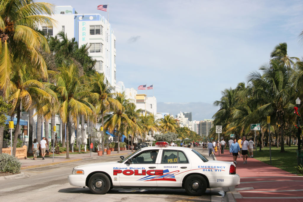 A police car parked on Ocean Drive.