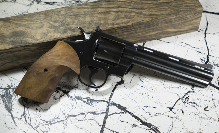 Magnum revolver with Bullet and leather background