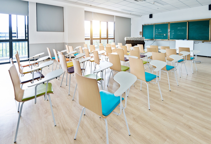 Empty classroom with desks and chairs for music lessons