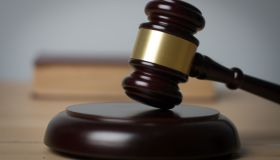 Close-Up Of Gavel On Table