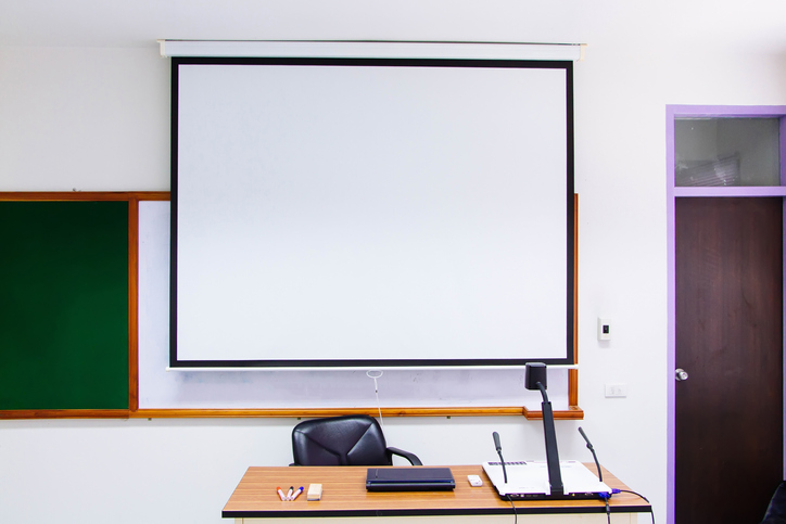 Projection Screen Hanging On Wall In Classroom