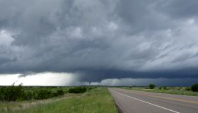 Diminishing perspective of road and tornado storm clouds, Guthrie, Texas, USA