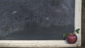 Apple Against Blackboard In Classroom