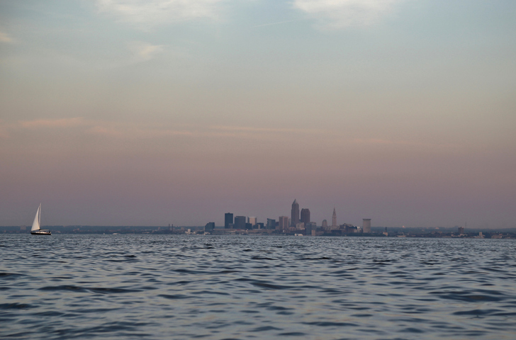 Long distance view of Cleveland city skyline frame Lake Erie