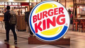 A traveller seen walking towards a fast-food hamburger...