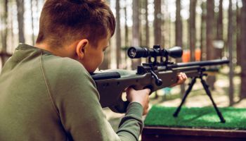 Teenager Learning How to Properly Shoot a Rifle