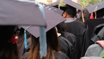 young women with graduation hat