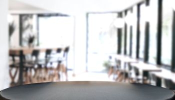 Close-Up Of Empty Table Against Defocused Background In Restaurant
