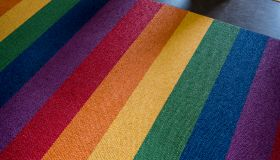 Rainbow flag colors on church carpet