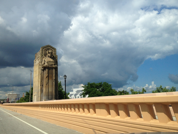 """View of Hope Memorial Bridge and """"Guardian of Traffic"""" sculptures from roadway Cleveland, Ohio"""