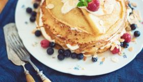 Lovingly stacked homemade pancakes pie with cream and fruits