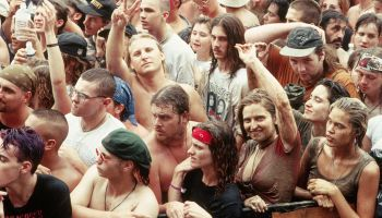 Man Giving Peace Sign in Woodstock '94 Crowd