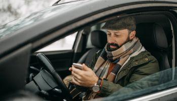 Mand driving car and talking
