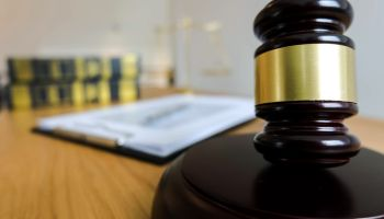 Close-Up Of Mallet And Gavel On Desk