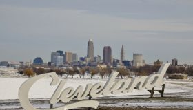 Cleveland Script tourist sign in front of the city skyline at winter season
